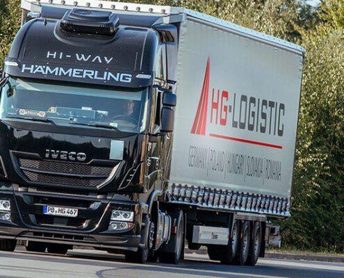 LKW der HG-Logistic auf einer Landstraße